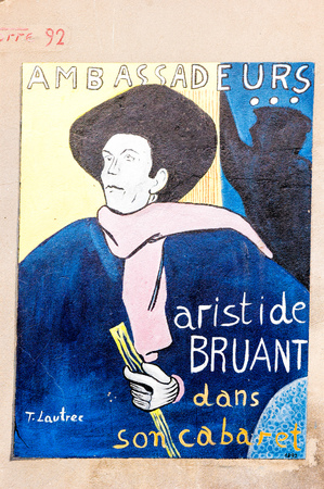 SaludecioItaly - March 15, 2005: A mural painting in Saludecio illustrating a poster of the french artist Aristide Bruant painted by Toulouse Lautrec