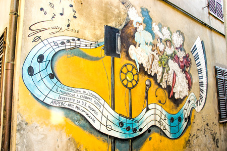 SaludecioItaly - March 15, 2005: A mural painting in Saludecio illustrating the invention of the carbon microphone by the English David Edward Hughes in 1878 Stock Photo