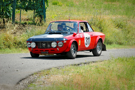 hf: Cremona  Italy -  September 7, 2005 - Unidentified drivers on a black and red vintage Lancia Fulvia racing car