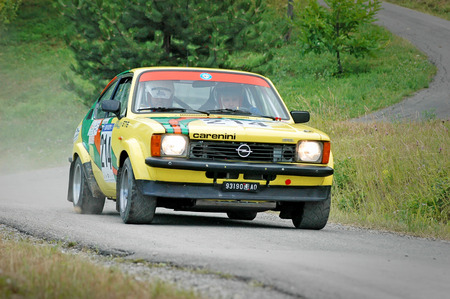 Cremona  Italy -  September 7, 2005 - Unidentified drivers on a yellow vintage Opel Kadett C Coupe racing car