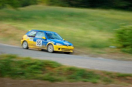 Cremona  Italy -  September 7, 2005 - Unidentified drivers on a yellow and blue vintage Peugeot 106 racing car