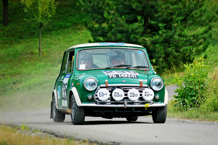 Cremona  Italy -  September 7, 2005 - Unidentified drivers on a green vintage Mini Innocenti racing car