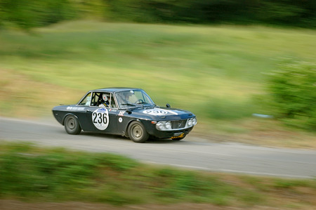 Cremona  Italy -  September 7, 2005 - Unidentified drivers on a black vintage Lancia Fulvia racing car
