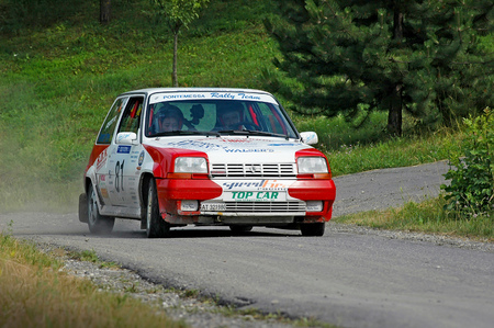 Cremona  Italy -  September 7, 2005 - Unidentified drivers on a white and red vintage Renault 5 racing car Editorial
