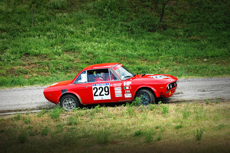 hf: Cremona  Italy -  September 7, 2005 - Unidentified drivers on a vintage Lancia Fulvia racing car Editorial