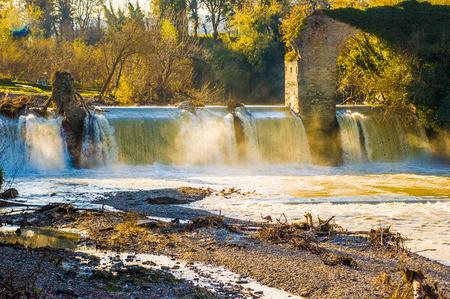 foglia: An old dam with a ruin of antique bridge over the Foglia river in Pontevecchio, Marche, Italy