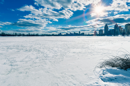 The frozen Dnieper river in Kiev, Ukraine, during winter. City buildings appeard in the background