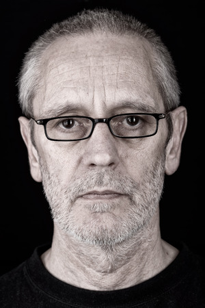 gaze: Portrait of a serious and confident man wearing glasses, with a penetrating gaze Stock Photo