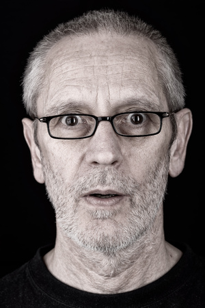 mimicry: Portrait of a surprised and confident man wearing glasses, with open mouth