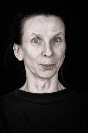 agape: Attractive adult woman portrait with appreciative expression on her face Stock Photo