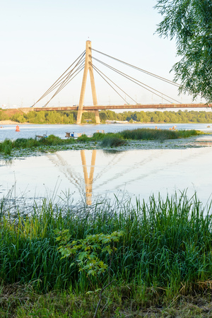 dnieper: A view of the Moskovsky  bridge over the Dnieper river in Kiev, Ukraine, during a blue summer evening Stock Photo