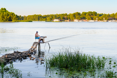 KievUkraine - August 09, 2016 - Fisherman on the Dnieper river, at evening, in Kiev the capital of Ukraine Stock Photo