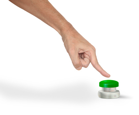 A man pushing a big green start/stop/alarm button with finger