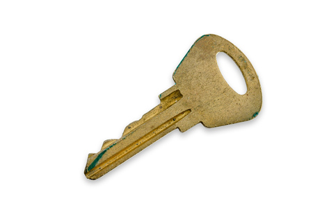 Scratched and ruined old modern key, isolated on white background Stock Photo
