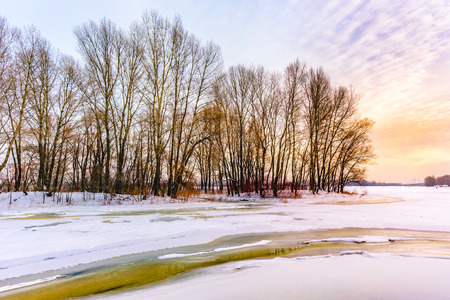 craquelure: Winter sun landscape with frozen water, ice and snow on the Dnieper river in Kiev, Ukraine Stock Photo