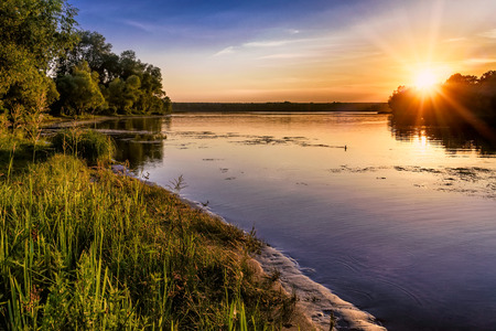 Sunset over the Dnieper river in Kiev, Ukraine, during a warm summer evening.