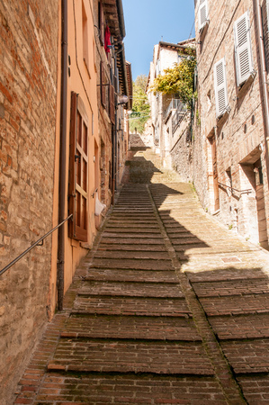 Stairs in a rising street in Urbino , a renaissance city in Marche, Italy