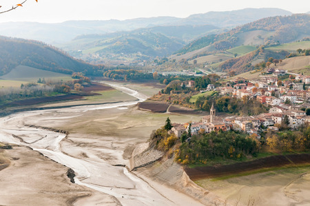 The dry Sassocorvaro lake and the town of Mercatale seen from the heights of Sassocorvaro in the Marche, Italy, Europe