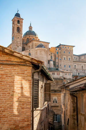 Wiew of the Cathedral (Duomo) of Urbino and the city houses, in Italy Stock Photo