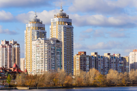 specular: High Obolon buildings near the Dnieper river in Kiev. It is sunrise time, in autumn Stock Photo