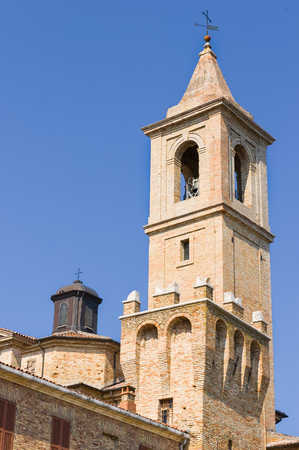 San Biagio churchs steeple on clear blue sky in Saludecio, a little medieval town in the Montefeltro, in the Emilia Romagna region, between Rimini and Urbino