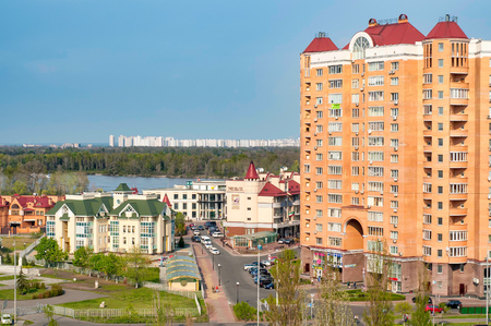 KievUkraine - April 30, 2011: View of the Obolon district of Kiev. High building, school, Golf center, Dnieper river, and in the background the buildings of the Troieshchyna district.