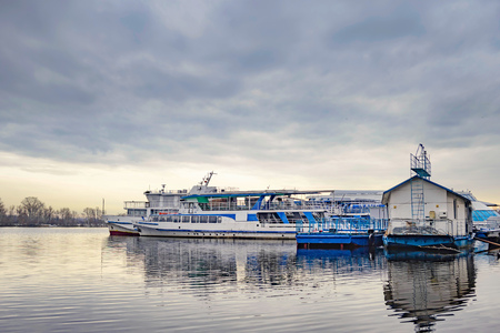 Boats on the Dnieper in Kiev, Ukraine during a gray winter afternoon
