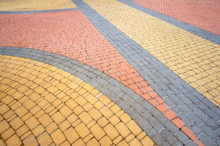 Detail of a nice artistic colorful cobblestones pavement in the Natalka park of Kiev, Ukraine Stock Photo