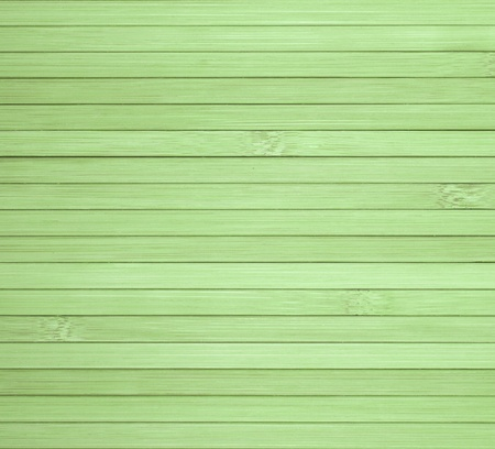 Background made of horizontal green bamboo laths. photo