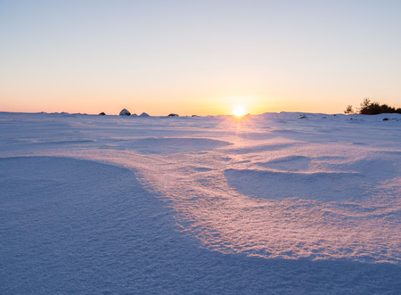 Beautiful winter landscape. Sunset in ices. Baltic Sea. Gulf of Finland. Russia. Stock Photo