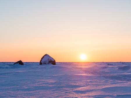 eventide: Beautiful winter landscape. Sunset in ices. Baltic Sea. Gulf of Finland. Russia.