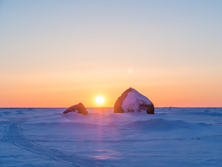Beautiful winter landscape. Sunset in ices. Baltic Sea. Gulf of Finland. Russia.