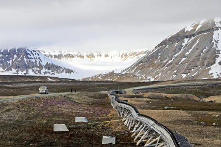 Because of the permafrost which makes the ground rock-hard and ice-cold the water pipes and drain lines run celestially