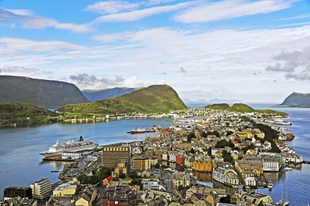 The city of Ãlesund is known for its Art Nouveau architecture, the surrounding fjords and the high peaks of the  Alps  From the roof terrace of Fjellstua you can enjoy the spectacular views over the unique panorama  The colorful town is situated in the se
