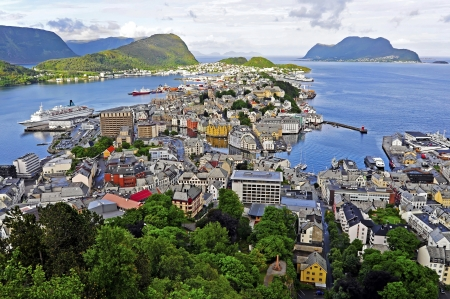 alesund: The city of Ãlesund is known for its Art Nouveau architecture, the surrounding fjords and the high peaks of the  Alps  From the roof terrace of Fjellstua you can enjoy the spectacular views over the unique panorama  The colorful town is situated in the se