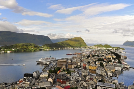 alesund:  The city of Ålesund is known for its Art Nouveau architecture, the surrounding fjords and the high peaks of the Sunnmøre Alps  From the roof terrace of Fjellstua you can enjoy the spectacular views over the unique panorama