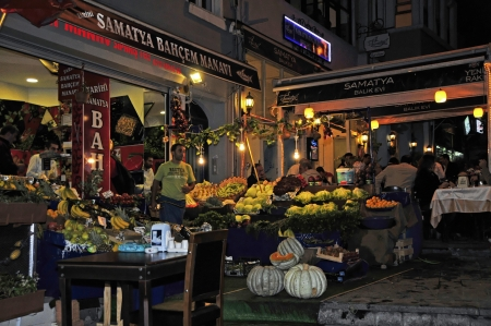influenced: Fruit and vegetable stand in the district Samatya at night  Istanbul   Samatya is a neighborhood located south of Istanbul  The small neighborhood is Greek influenced Georgian and Armenian  There you can eat very cheap and good fish  In addition, you meet Editorial
