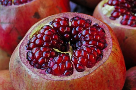 halved  half: Been skiing Ttene pomegranates on a small stall in the Istanbul inner state  theGrant apples were pressed and sold as a delicious and healthy juice  Stock Photo