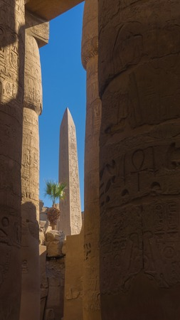 Ruins of an ancient temple of Egypt with statues and columns