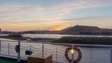 Watching sunset standing on Egyptiajn cruise ship Stock Photo