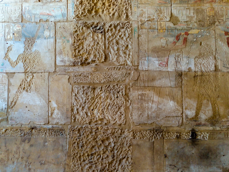 thebes: Engravings on the wall of the ancient temple of Egypt. Stock Photo