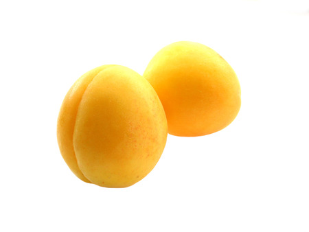 two sweet wet apricots on white background Stock Photo - 1447609