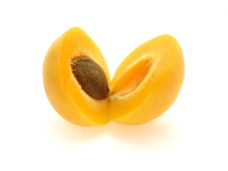 sectioned: One ripe apricot sectioned by knife on white background