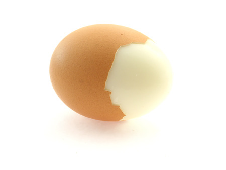 scraped: scraped brown egg isolated on white background Stock Photo