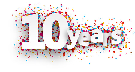 Ten  years paper sign over confetti. Vector holiday illustration.