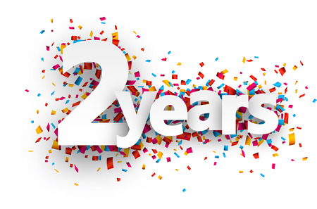two year: Two years paper sign over confetti. Vector holiday illustration.