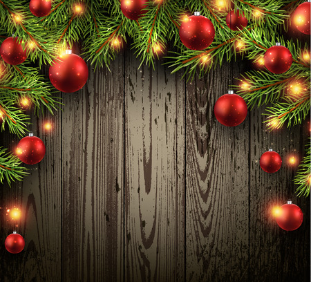christmas red: Christmas wooden background with fir branches and balls.