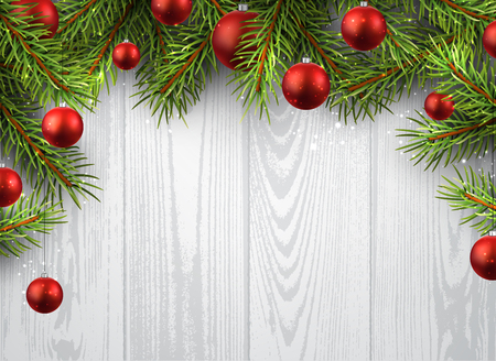 holiday background: Christmas wooden background with fir branches and balls.