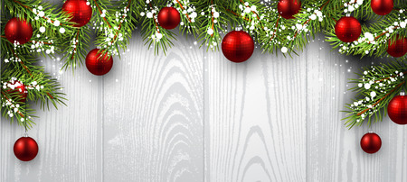 green banner: Christmas wooden background with fir branches and balls.