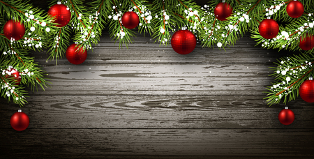 christmas holiday background: Christmas wooden background with fir branches and balls.